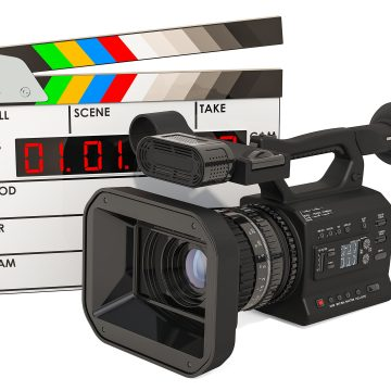 Cinema concept. Professional video camera with digital clapperbo